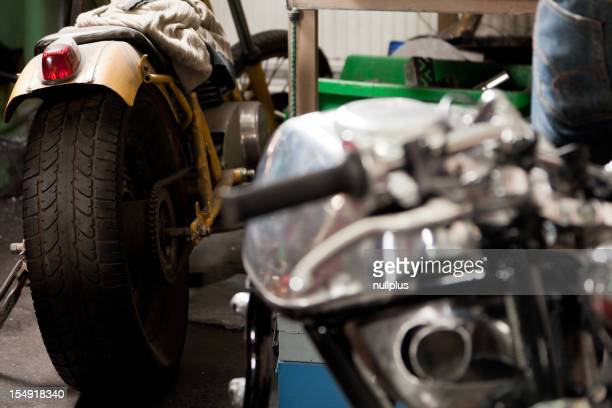 custom motorcycle parts in a workshop