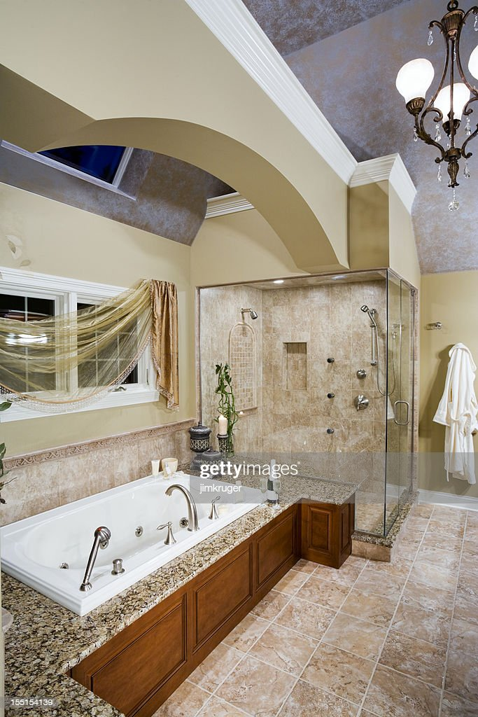 Custom neutral toned master bathroom with jacuzzi tub stock photo getty images for Master bathroom with jacuzzi tub