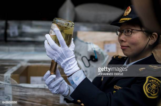 A custom officer checks a bottle of Champagne out of the LyonWuhan train after its arrival at the Hanxinou Railway Terminal in Wuhan capital of...