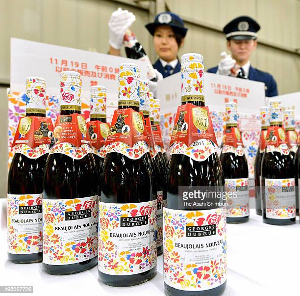 Custom officers inspect the bottles of Beaujolais Nouveau arriving at Kansai International Airport on October 31 2015 in Izumisano Osaka Japan