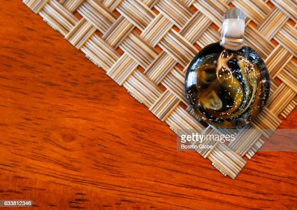 A customdesigned glass cremation bead that contains a bit of ash from the remains of a beloved pet is seen inside Vangie Collins's showroom in Nashua...