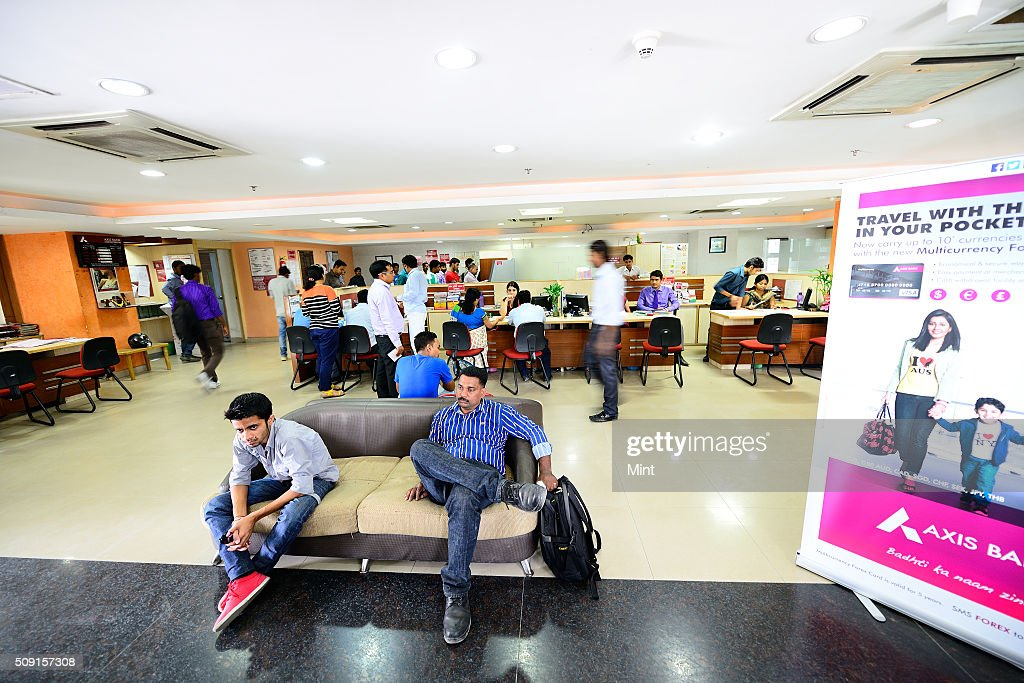 Customer accessing services of Axis bank on July 9, 2014 in New Delhi, India.