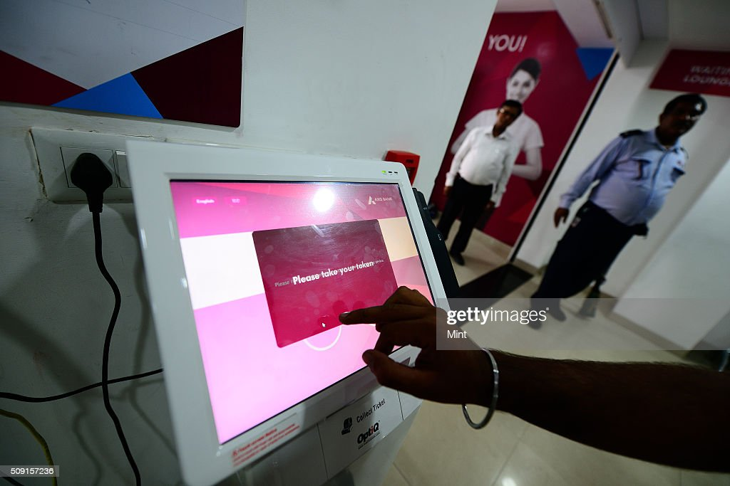 Customer accessing services of Axis bank with touch screen panel on July 9, 2014 in New Delhi, India.