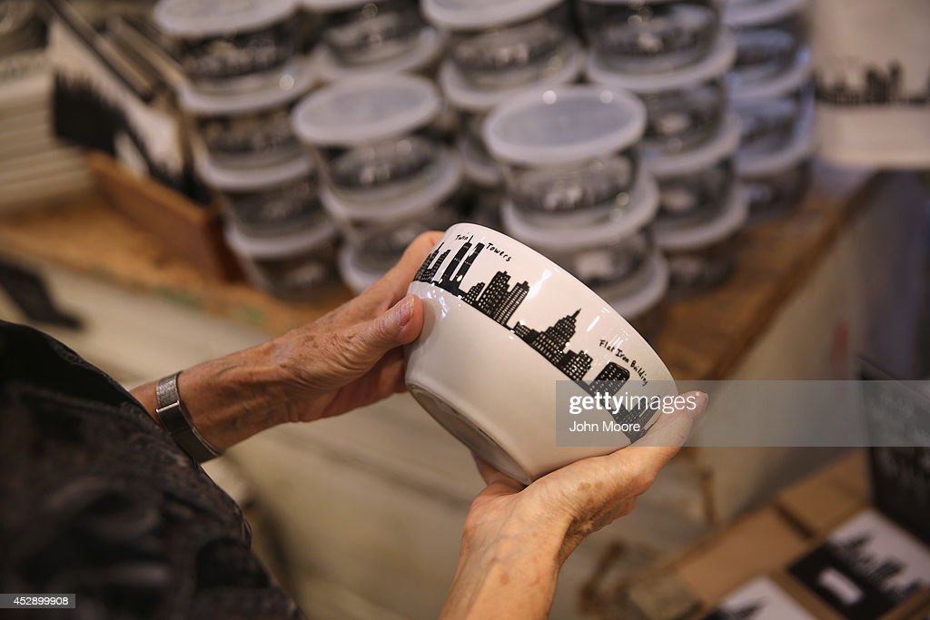 A customer admires a bowl from the '212 New York Skyline' collection sit on a display shelf at Fishs Eddy, a well-known housewares store on Broadway and 19th St. in Manhattan on July 29, 2014 in New York City. The Port Authority of New York and New Jersey has accused the shop of 'unfairly reaping a benefit from an association with the Port Authority and the attack' of September 11. The Authority has asked the store to stop selling anything with these 'assets' on them, such as the Twin Towers, One World Trade Center and the Lincoln and Holland tunnels.