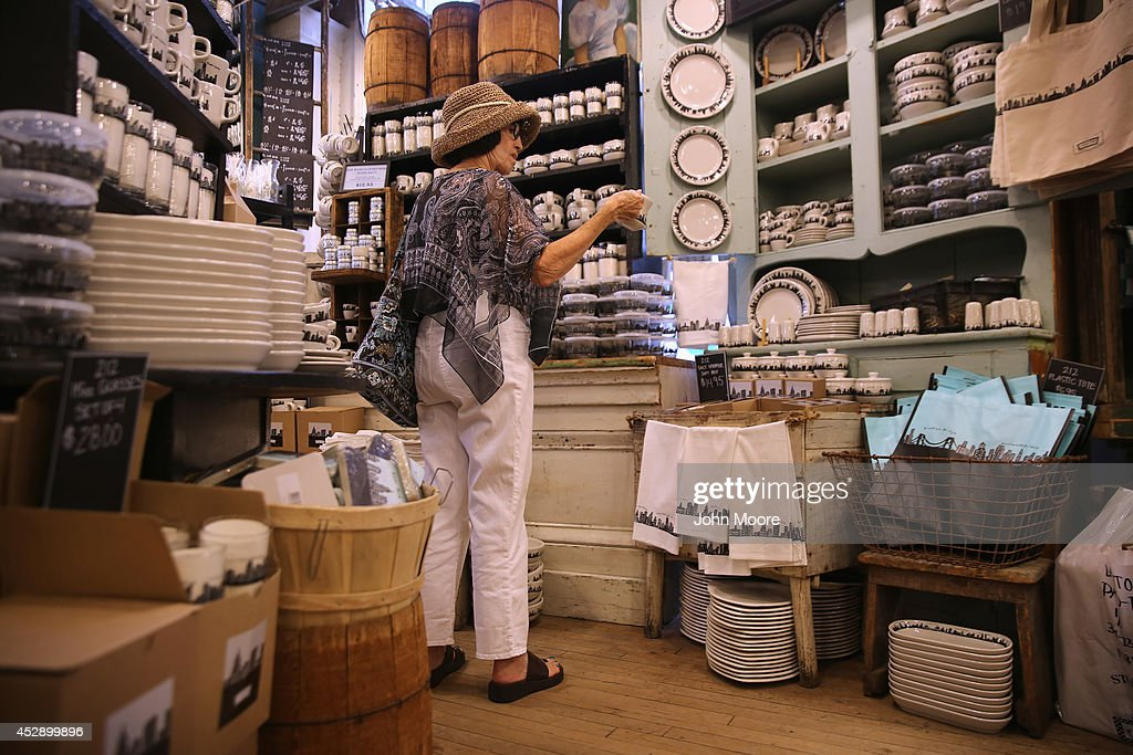 A customer admires a cup from the '212 New York Skyline' collection sit on a display shelf at Fishs Eddy, a well-known housewares store on Broadway and 19th St. in Manhattan on July 29, 2014 in New York City. The Port Authority of New York and New Jersey has accused the shop of 'unfairly reaping a benefit from an association with the Port Authority and the attack' of September 11. The Authority has asked the store to stop selling anything with these 'assets' on them, such as the Twin Towers, One World Trade Center and the Lincoln and Holland tunnels.