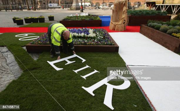 Customer and Community Engagement Manager for Manchester City Council Mel Kirby work on the Jubilee Garden outside Manchester Town Hall ahead of the...
