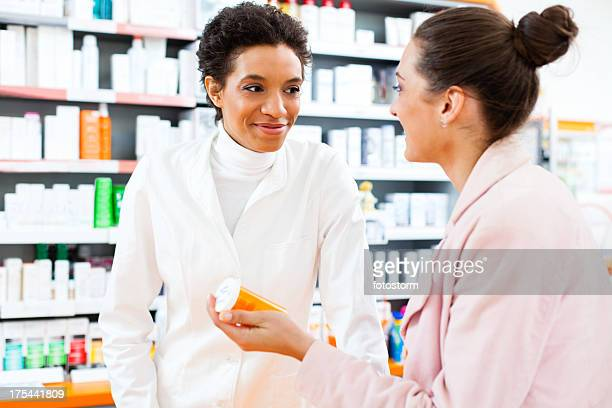 Customer and pharmacist in the pharmacy