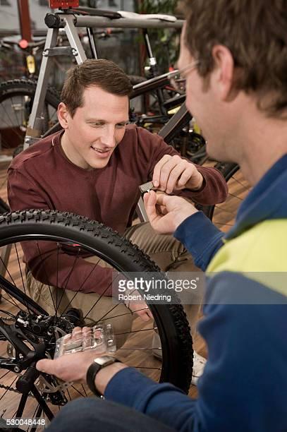 Customer and salesman in bike shop