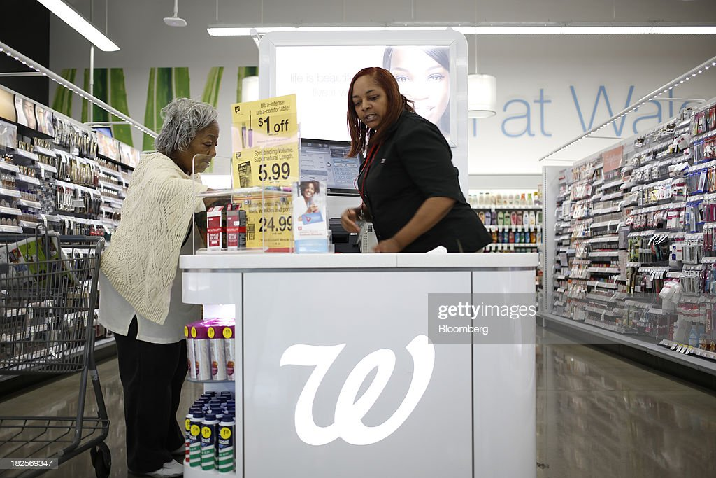 Customer Anna Board, left, checks out in the cosmetics section of a Walgreen Co. store in Louisville, Kentucky, U.S., on Monday, Sept. 30, 2013. Walgreen Co., the biggest U.S. drugstore chain, is expected to report fourth-quarter earnings before the opening of U.S financial markets on Oct. 1. Photographer: Luke Sharrett/Bloomberg via Getty Images