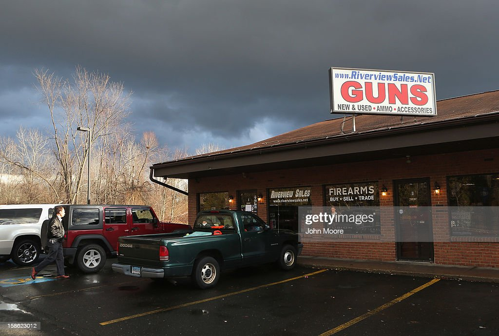 A customer approaches the closed Riverview Gun Sales shop on December 21, 2012 in East Windsor, Connecticut. According to the Hartford Courant, sources investigating the massacre at the Sandy Hook Elementary School in Newtown have said the Bushmaster rifle used by the gunman Adam Lanza was legally purchased at the shop by his mother Nancy Lanza. The Courant also reports that records show the guns used in a previous mass shooting in Connecticut in 2010, where Omar Thornton killed eight people and himself at Hartford Distributers Inc, were also purchased at Riverview Gun Sales. On Thursday agents from the federal Bureau of Alcohol, Tobacco, Firearms and Explosives (ATF), and local police raided and closed the gun shop.
