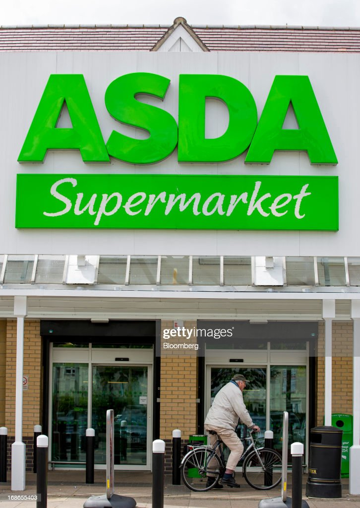 A customer arrives by bicycle at an Asda supermarket store, operated by Wal-Mart Stores Inc., in the Richmond borough of London, U.K., on Monday, May 13, 2013. Asda, the U.K. supermarket chain owned by Wal-Mart Stores Inc., said sales rose 4.5 percent last year and it's investing 700 million pounds ($1 billion) into stores and online operations. Photographer: Jason Alden/Bloomberg via Getty Images