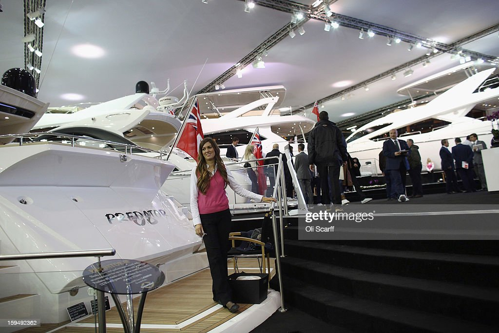 A customer assistant waits by a powerboat on the Sunseeker stand at the 2013 London Boat Show, held at the ExCeL Centre, on January 14, 2013 in London, England. Until January 20, 2013 the London Boat Show will showcase, demonstrate and sell maritime equipment ranging from luxury yachts to dinghies.