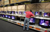 A customer at a Best Buy store looks at a display of LCD flat panel televisions October 23 2006 in Marin City California According to the market...