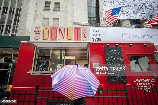 A customer at a Square equipped food truck outside the New York Stock Exchange during Square's initial public offering on Thursday November 19 2015...