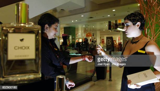 A customer at Selfridges store in west London tests the scentless Choix 'perfume' priced at 30 per bottle