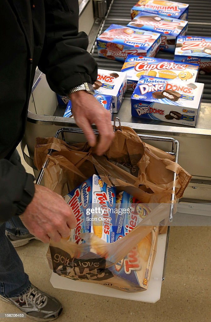 A customer bags his purchase of Hostess snacks at a Jewel-Osco grocery store on December 11, 2012 in Chicago, Illinois. The Jewel-Osco grocery store chain purchased the last shipment of 20,000 boxes of Hostess products and put them on sale in their stores throughout the Chicago area today. Hostess Brands Inc. shut down its baking operations and began liquidating assets last month after failing to negotiate a labor contract with Workers with the Bakery, Confectionery, Tobacco Workers and Grain Millers International Union