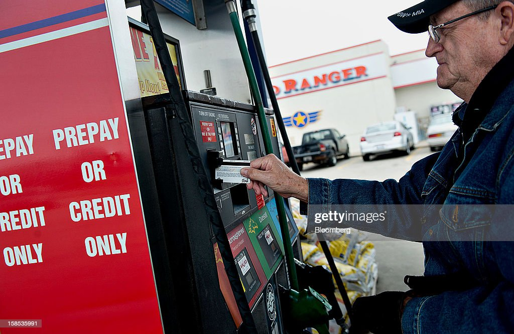 Customer Bob Dalziel swipes his credit card as he prepares to fill his truck with fuel at a gas station in Princeton, Illinois, U.S., on Tuesday, Dec. 18, 2012. Retail gasoline in the U.S. fell to the lowest level in a year as refineries restored production and stockpiles rose to an eight-month high, blunting criticism of President Barack Obama's energy policies. Photographer: Daniel Acker/Bloomberg via Getty Images