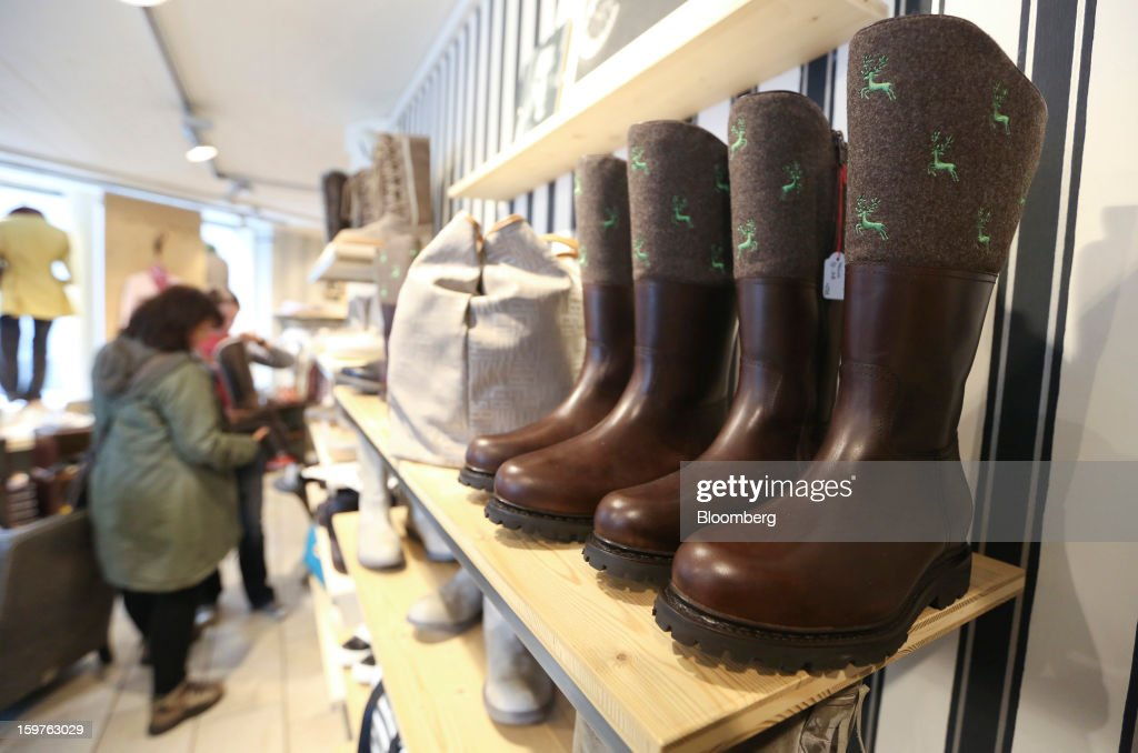 A customer browses a selection of footwear on sale at the Allenbach clothes store in the town of Davos, Switzerland, on Saturday, Jan. 19, 2013. Next week the business elite gather in the Swiss Alps for the 43rd annual meeting of the World Economic Forum in Davos, the five day event runs from Jan. 23-27. Photographer: Chris Ratcliffe/Bloomberg via Getty Images