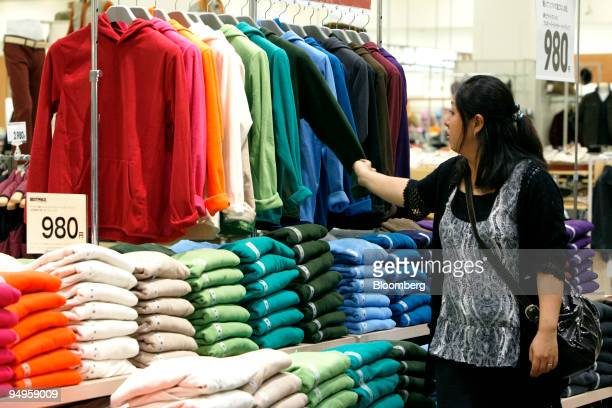 A customer browses Aeon Co's privatebrand fleece sweaters at the company's Jusco store in the Aeon Tsudanuma shopping center in Narashino City Chiba...