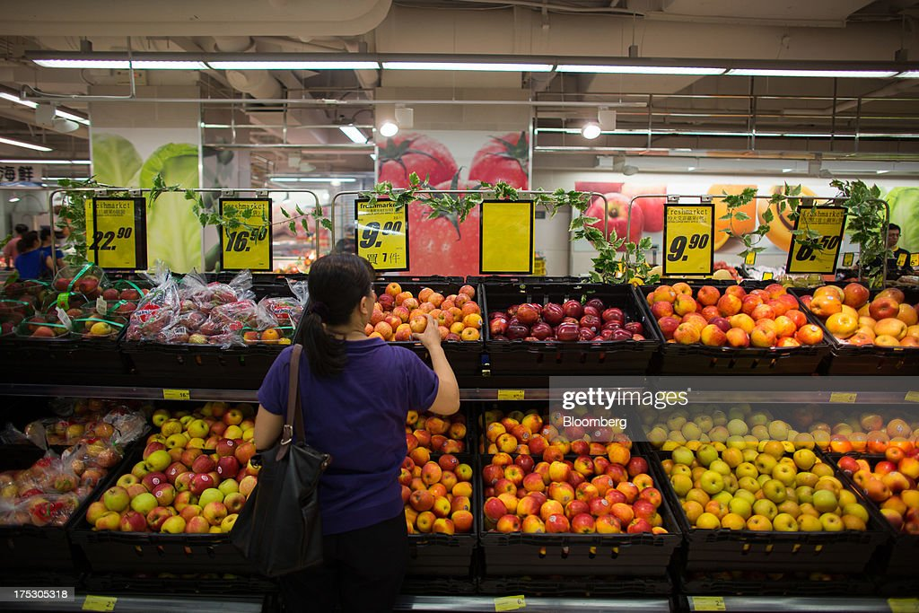A customer browses apples at a ParknShop Superstore supermarket, operated by Hutchison Whampoa Ltd., in Hong Kong, China, on Thursday, Aug. 1, 2013. KKR & Co., the private-equity firm run by Henry Kravis and George Roberts, is evaluating a bid for Hong Kong supermarket chain ParknShop, according to two people with knowledge of the matter. Hutchison is seeking $3 billion to $4 billion for the chain and has asked potential buyers to submit bids by Aug. 16, people with knowledge of the process have said. Photographer: Lam Yik Fei/Bloomberg via Getty Images