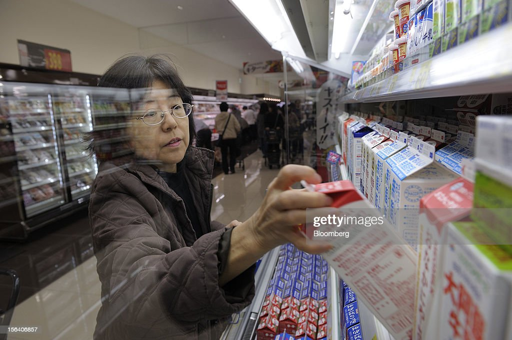 A customer browses cartons of milk in a Seiyu GK supermarket in Tokyo, Japan, on Wednesday, Nov. 14, 2012. Seiyu GK is a unit of Wal-Mart Stores Inc. Photographer: Akio Kon/Bloomberg via Getty Images