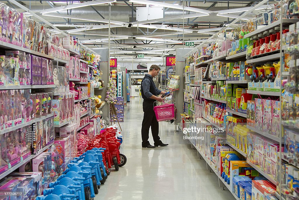 A customer browses children's toys for sale inside a Game supermarket, part of Massmart Holdings Ltd, in the Fourways district of Johannesburg, South Africa, on Thursday, Aug. 22, 2013. Massmart Holdings Ltd., the South African food and goods wholesaler owned by Wal-Mart Stores Inc., said revenue growth continued to slow in August after a downturn in consumer spending hurt first-half earnings. Photographer: Nadine Hutton/Bloomberg via Getty Images