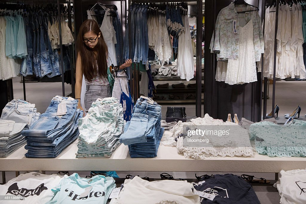 A customer browses clothes at a Zara store, operated by ...
