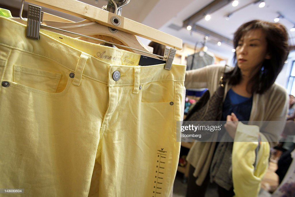 A customer browses clothes at an American Eagle Outfitters Inc. store in Tokyo, Japan, on Wednesday, April 18, 2012. American Eagle Outfitters Inc., a retailer of men's and women's casual apparel, opened its first store in Japan inside the Tokyu Plaza Omotesando Harajuku retail complex in the Omotesando district of Tokyo today. Photographer: Kiyoshi Ota/Bloomberg via Getty Images