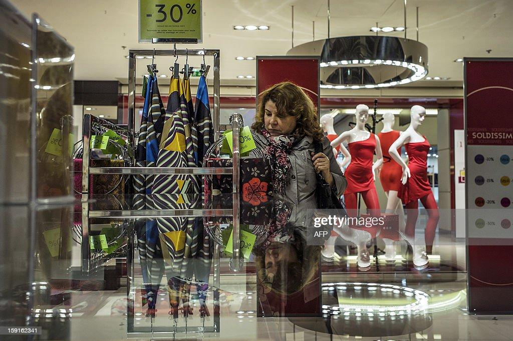 A customer browses clothes at the Galeries Lafayette department store in Lyon, on January 9, 2013, during the official start of winter sales.