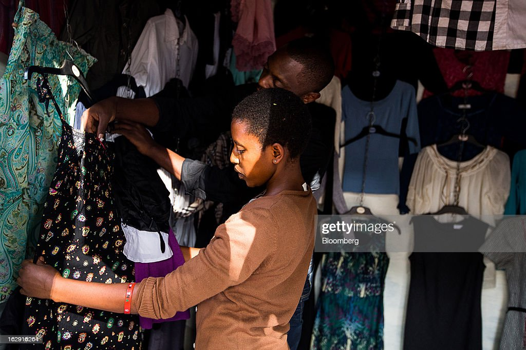 A customer browses dresses for sale at a store in Nairobi, Kenya, on Friday, March 1, 2013. Next week's presidential vote will be the first since disputed elections in 2007 triggered ethnic fighting in which more than 1,100 people died and another 350,000 fled their homes. Photographer: Trevor Snapp/Bloomberg via Getty Images