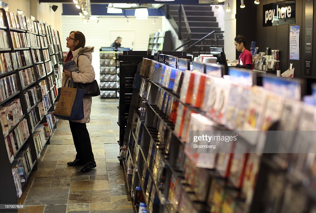 A customer browses DVDs on display inside a HMV pop-up store in London, U.K., on Tuesday, Nov. 27, 2012. Fashion chain Hobbs is among those that have opened pop-up stores for the first time this year, while CD and DVD retailer HMV Group Plc is adding more than usual for the holiday in an effort to win business. Photographer: Chris Ratcliffe/Bloomberg via Getty Images