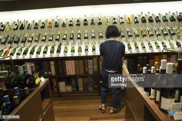 A customer browses European wines at the Isetan Shinjuku department store operated by Isetan Mitsukoshi Holdings Ltd in Tokyo Japan on Tuesday July...