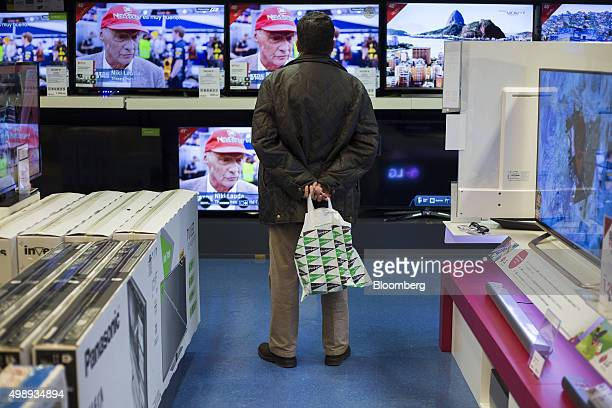 A customer browses flat screen televisions while shopping at the El Cortes Ingles SA department store on Black Friday in central Madrid Spain on...