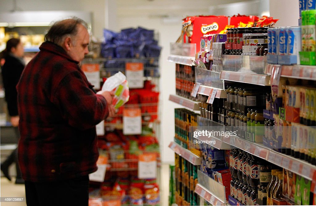 A customer browses food produce displayed for sale inside the Community shop, a supermarket for low-income families, in Goldthorpe, U.K., on Monday, Dec. 23, 2013. Company Shop Ltd. created the Community shop for people in, or bordering on, food poverty, selling surplus goods from major retailers at discounted prices. Photographer: Paul Thomas/Bloomberg via Getty Images