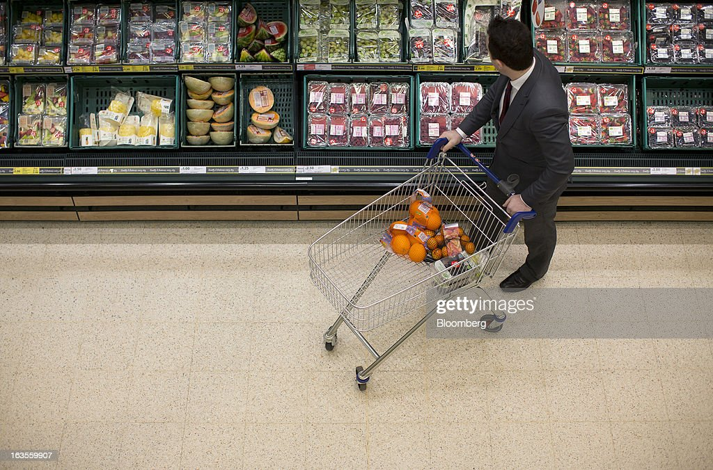 A customer browses fresh fruit in the chilled section of a Tesco Plc supermarket in the borough of Kensington in London, U.K., on Tuesday, March 12, 2013. Tesco Plc, the U.K.'s largest grocer launched a 'Price Promise', its latest initiative offering to match the price of customers' purchases to that of it's rivals, including Wal-Mart Stores Inc.'s ASDA. Photographer: Simon Dawson/Bloomberg via Getty Images