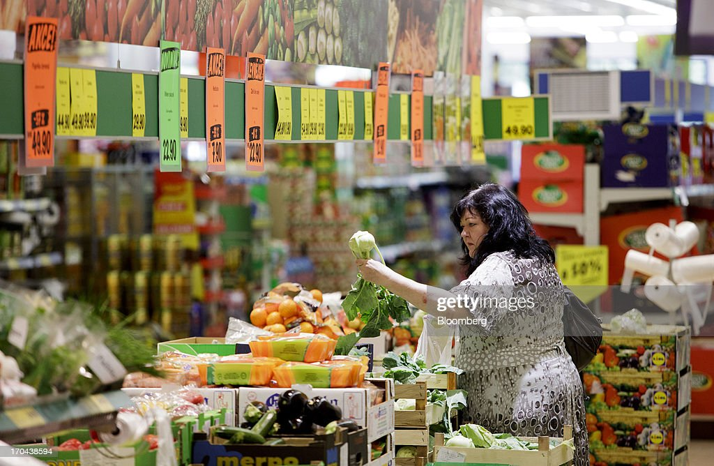 A customer browses fresh vegetables for sale inside a Lidl discount supermarket store, operated by Schwarz Group, in Prague, Czech Republic, on Thursday, June 13, 2013. Ahold and Tesco are tied as the Czech Republic's third-largest grocer by revenue behind Lidl discount store owner Schwarz Group and Rewe AV, which owns the Billa supermarkets, according to Krakow, Poland-based market researcher PMR. Photographer: Martin Divisek/Bloomberg via Getty Images