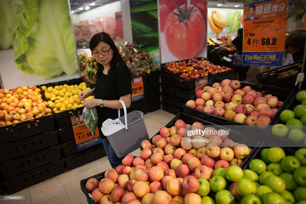 A customer browses fruits at a ParknShop Superstore supermarket, operated by Hutchison Whampoa Ltd., in Hong Kong, China, on Thursday, Aug. 1, 2013. KKR & Co., the private-equity firm run by Henry Kravis and George Roberts, is evaluating a bid for Hong Kong supermarket chain ParknShop, according to two people with knowledge of the matter. Hutchison is seeking $3 billion to $4 billion for the chain and has asked potential buyers to submit bids by Aug. 16, people with knowledge of the process have said. Photographer: Lam Yik Fei/Bloomberg via Getty Images