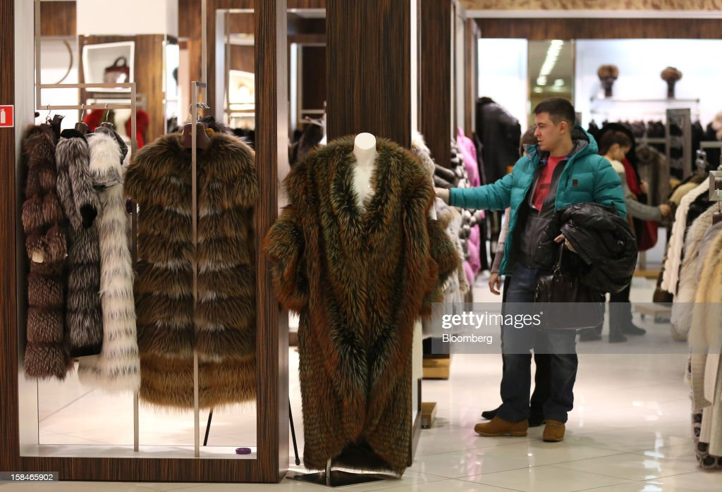 A customer browses fur coats on display at the World of Fur and Leather store in Moscow, Russia, on Sunday, Dec. 16, 2012. Russia's government should introduce a tax on luxury consumption in first half of 2013, President Vladimir Putin said in state-of-the-nation address in Moscow. Photographer: Andrey Rudakov/Bloomberg via Getty Images