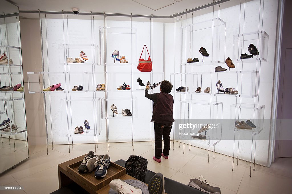 A customer browses Geox SpA shoes displayed for sale inside the company's flagship store in the Central district of Hong Kong, China, on Friday, April 12, 2013. Hong Kong's economy expanded 1.4 percent in 2012 and Financial Secretary John Tsang is projecting growth of 1.5 percent to 3.5 percent this year. Photographer: Jerome Favre/Bloomberg via Getty Images