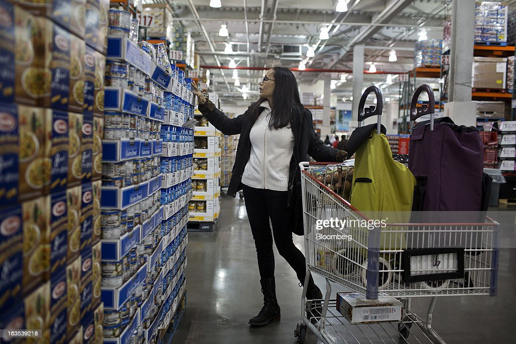 A customer browses goods at a Costco Wholesale Corp. store in New York, U.S., on Monday, March 11, 2013. Costco is expected to release quarterly earnings results on March 12. Photographer: Victor J. Blue/Bloomberg via Getty Images