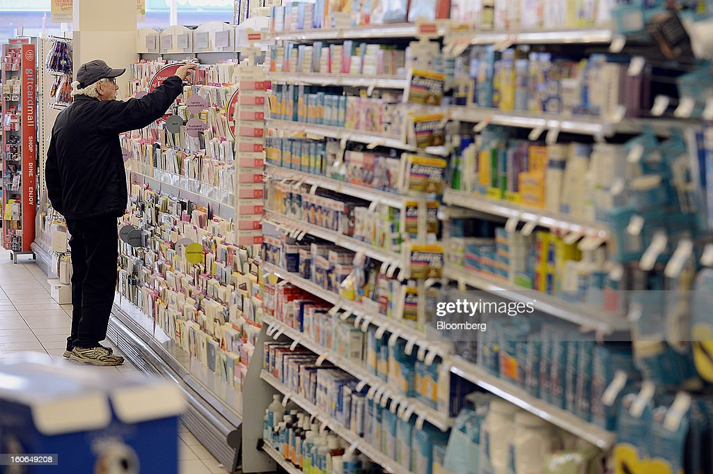 A customer browses greeting cards at a Shoppers Drug Mart Corp. store in Toronto, Ontario, Canada, on Monday, Feb. 4, 2013. Shoppers Drug Mart Corp., Canada's largest pharmacy chain, is scheduled to release earnings data on Feb. 7. Photographer: Aaron Harris/Bloomberg via Getty Images