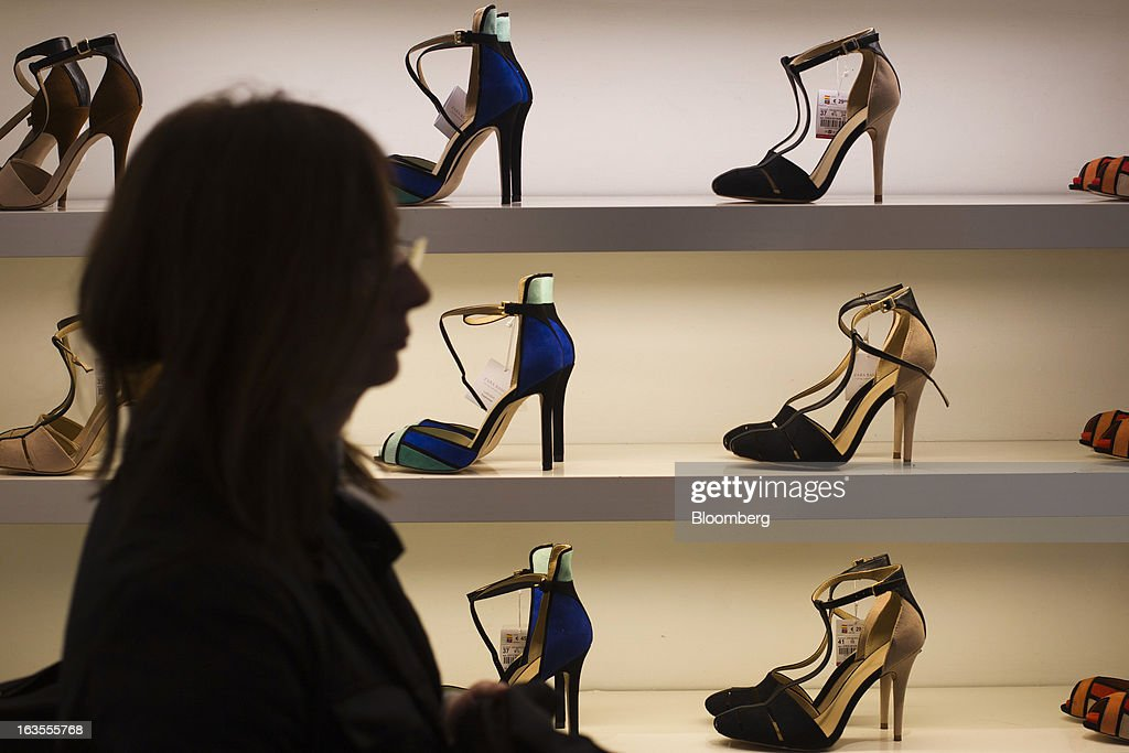A customer browses high-heeled shoes displayed for sale inside a Zara fashion store, operated by Inditex SA, in Madrid, Spain, on Tuesday, March 12, 2013. Europe's richest man, Amancio Ortega, the 76-year-old founder of Inditex SA, the world's biggest clothing retailer and owner of the Zara clothing chain, is No. 3 on Standard & Poor's 500 Index with a net worth of $57.4 billion, $4.9 billion ahead of Warren Buffett, 82. Photographer: Angel Navarrete/Bloomberg via Getty Images