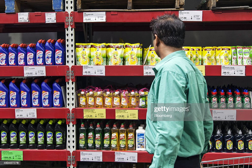 A customer browses home-care products on display at a Walmart India Pvt. Best Price Modern Wholesale store in the town of Zirakpur on the outskirts of Chandigarh, Punjab, India, on Tuesday, June 10, 2014. India's consumer price index (CPI) figures and wholesale price inflation figures for May are scheduled for release on June 12 and 16 respectively. Photographer: Udit Kulshrestha/Bloomberg via Getty Images