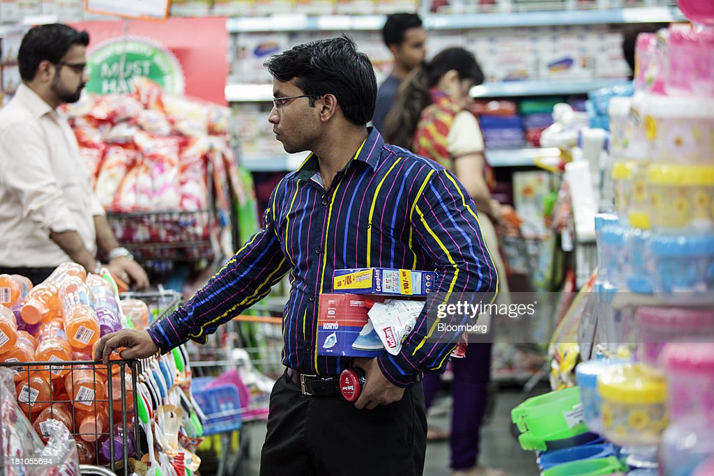 A customer browses household goods at the Big Bazaar Hypermarket store in Noida, India, on Monday, Sept. 9, 2013. Indias rupee fell, snapping the biggest four-day surge in 40 years, on concern slowing growth will deter inflows needed to reduce the current-account deficit. Photographer: Prashanth Vishwanathan/Bloomberg via Getty Images