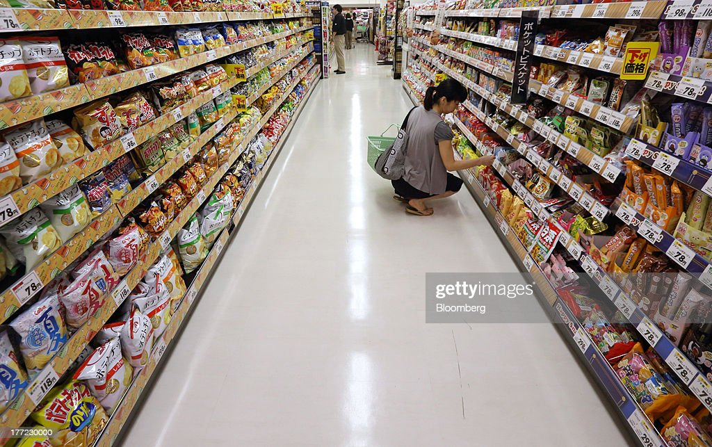 A customer browses in the confectionery section at an Aeon Co. supermarket during a sale jointly held with Daiei Inc. at an Aeon supermarket in Tokyo, Japan, on Thursday, Aug. 22, 2013. Aeon's acquisition of 48.4 million Daiei shares will take place on Aug. 27 after the completion of tender offer yesterday, according to a statement to the Tokyo Stock Exchange released today. Photographer: Tomohiro Ohsumi/Bloomberg via Getty Images