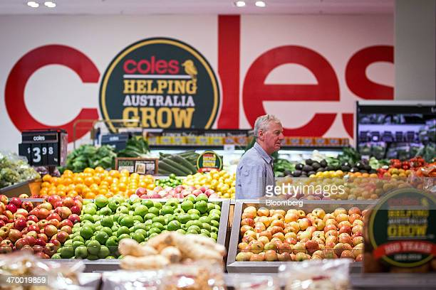 A customer browses in the produce section of a Coles supermarket operated by Wesfarmers Ltd in Sydney Australia on Tuesday Feb 18 2014 Wesfarmers...