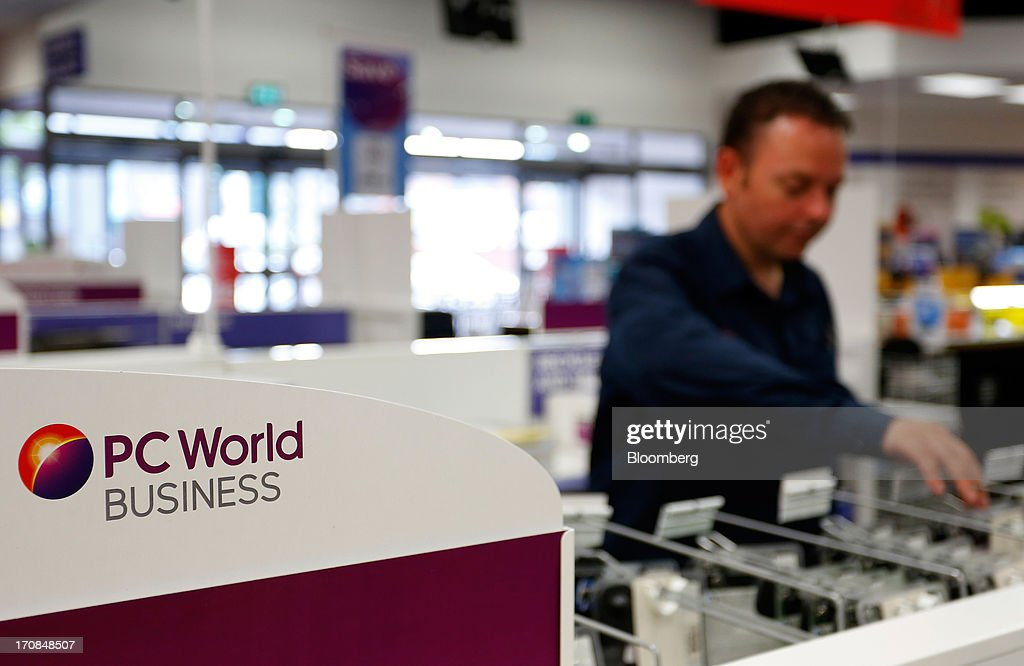 A customer browses items displayed for sale inside a Currys PC World 2 in 1 store, operated by Dixons Retail Plc, in Manchester, U.K., on Tuesday, June 18, 2013. Dixons Retail Plc, the U.K.'s largest consumer-electronics retailer, said last month it will report annual pretax profit at the 'top end' of analysts' predictions after fourth-quarter revenue beat estimates on increased sales of tablets and services such as software tutorials. Photographer: Paul Thomas/Bloomberg via Getty Images