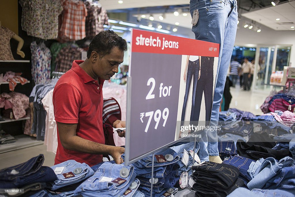 A customer browses jeans at the Fashion at Big Bazaar (FBB) section of the Big Bazaar Hypermarket store in Noida, India, on Monday, Sept. 9, 2013. Indias rupee fell, snapping the biggest four-day surge in 40 years, on concern slowing growth will deter inflows needed to reduce the current-account deficit. Photographer: Prashanth Vishwanathan/Bloomberg via Getty Images