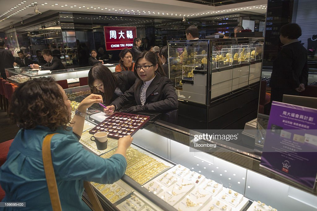 A customer browses jewelry in a Chow Tai Fook Jewellery Group Ltd. store in the Central district of Hong Kong, China, on Wednesday, Jan. 16, 2013. Chow Tai Fook Jewellery, the world's biggest jeweler by market value, posted an 8 percent drop in third-quarter same-store sales as Chinese shoppers curbed spending amid a slower economy. Photographer: Jerome Favre/Bloomberg via Getty Images