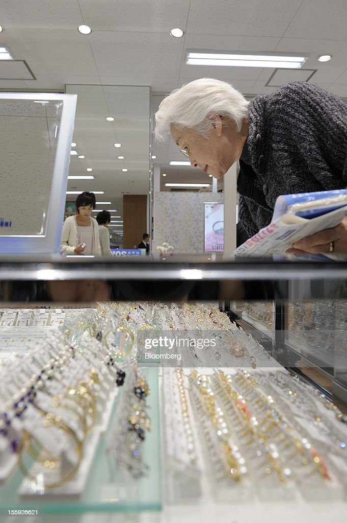 A customer browses jewelry in an Aeon Co. shopping center in Tokyo, Japan, on Friday, Nov. 9, 2012. Aeon Co. is Japan's largest supermarket operator. Photographer: Akio Kon/Bloomberg via Getty Images